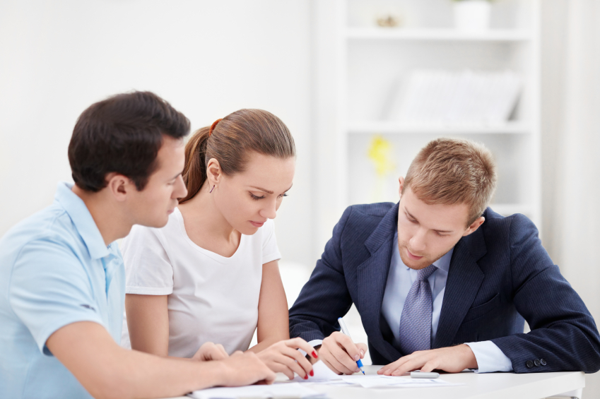 A financial advisor working with a young couple